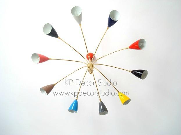 Lámpara sputnik araña stilnovo con brazos de latón