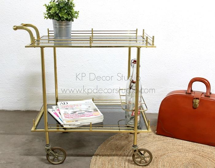 Carrito con ruedas vintage dorado