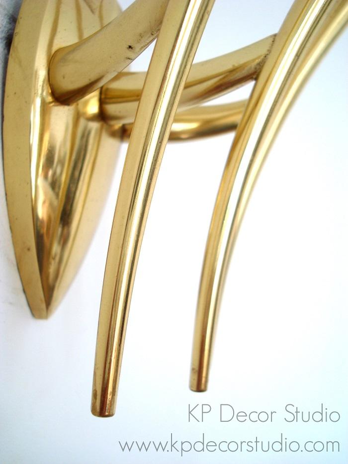 lamparas de pared doradas estilo midcentury